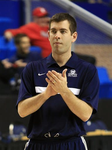 Butler head coach Brad Stevens aplaudes his team during practice for the second round of the NCAA college basketball tournament Wednesday, March 20, 2013, in Lexington, Ky. Butler play Bucknell on Thursday. (AP PhotoJames Crisp)