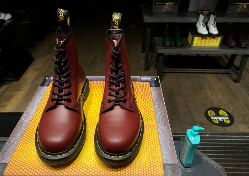 FILE PHOTO: A pair of Dr. Martens boots is seen through the window of a Dr Martens store in London
