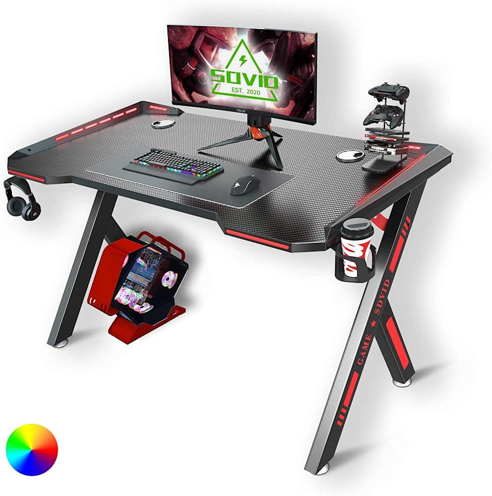 <p>Designate the gaming corner with this <span>Gaming Desk with LED RGB Lights</span> ($93).</p>