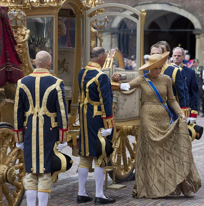 Netherlands Queen Maxima arrives at the Hall of Knights for the officially opening of the new parliamentary year with a speech delivered by her husband King Willem-Alexander outlining the government's plan and budget policies for the year ahead in The Hague, Netherlands, Tuesday, Sept. 17, 2013. (AP Photo/Peter Dejong)