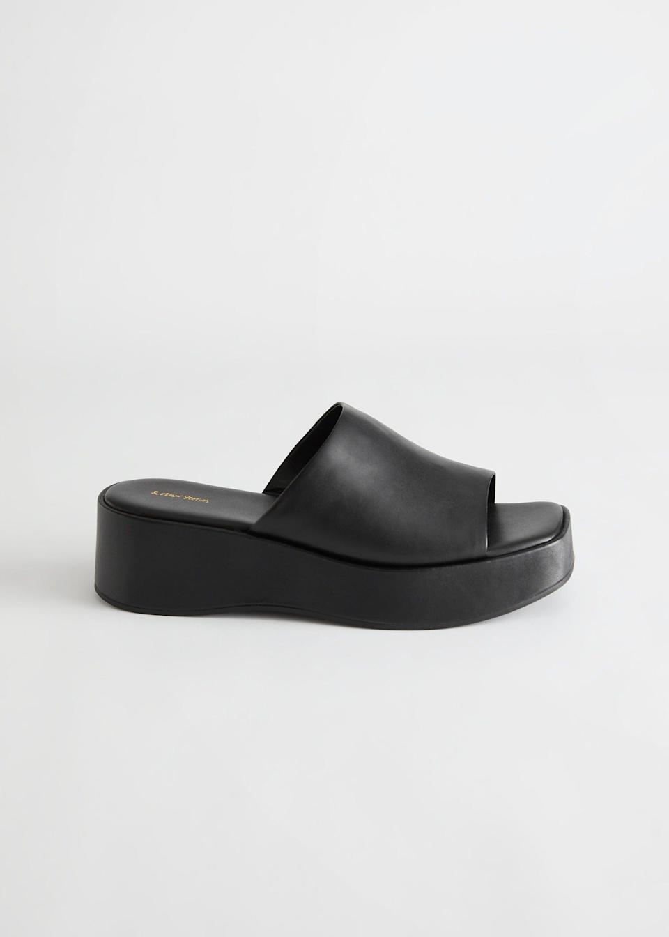 """<br><br><strong>& Other Stories</strong> Leather Platform Sandals, $, available at <a href=""""https://www.stories.com/en_gbp/shoes/heeled-sandals/product.leather-platform-sandals-black.0935221001.html"""" rel=""""nofollow noopener"""" target=""""_blank"""" data-ylk=""""slk:& Other Stories"""" class=""""link rapid-noclick-resp"""">& Other Stories</a>"""