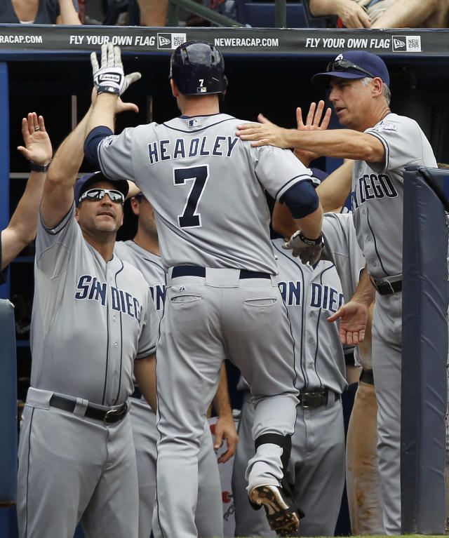 San Diego Padres' Chase Headley celebrates with teammates after hitting a home run in the sixth inning of a baseball game against the Atlanta Braves at Turner Field on Sunday, Sept. 15, 2013, in Atlanta. (AP Photo/Butch Dill)