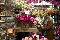 FILE PHOTO: A woman visits the floating flower market in Amsterdam