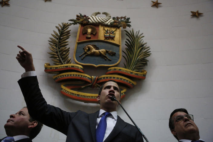 Opposition leader Juan Guaido speaks at the National Assembly in Caracas, Venezuela, Tuesday, Jan. 7, 2020. Guaidó and lawmakers who back him, pushed their way into the legislative building on Tuesday following an attempt by rival legislators to take control of the congress, and declared Guaidó the president of the only opposition-controlled institution. (AP Photo/Andrea Hernandez Briceño)