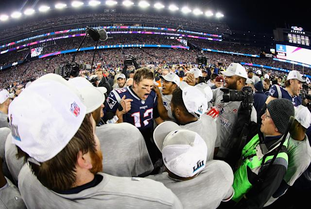 <p>Tom Brady #12 of the New England Patriots celebrates with teammates after winning the AFC Championship Game against the Jacksonville Jaguars at Gillette Stadium on January 21, 2018 in Foxborough, Massachusetts. (Photo by Maddie Meyer/Getty Images) </p>