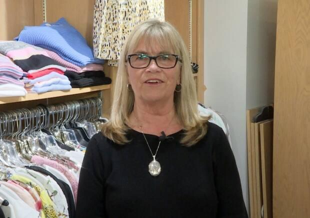 Gail Decker, owner of Gail's Clothing Company, has rebranded her clothing company after 24 years in business, following a legal battle with a huge U.K. clothing company with the same name. (Jeremy Eaton/CBC - image credit)