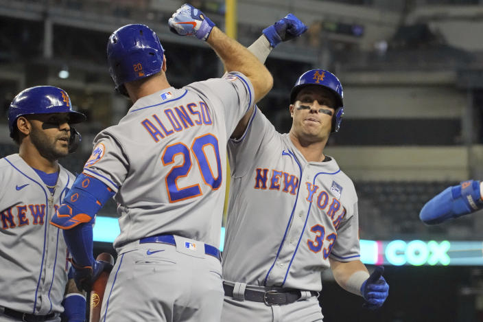 New York Mets' James McCann (33) celebrates with Pete Alonso (20) after hitting a three-run home run in the first inning during a baseball game against the Arizona Diamondbacks, Wednesday, June 2, 2021, in Phoenix. (AP Photo/Rick Scuteri)