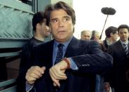 Former French tycoon Bernard Tapie arrives at court in a fraud trial over his defunct business empire