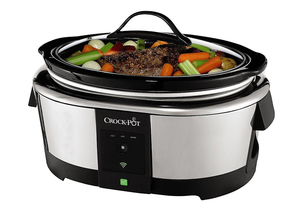 """<p>You can program this wifi-enabled slow cooker from anywhere you can get a signal. in legit <em>Smart House</em> fashion, the app lets you turn it on and off and control the temperature.</p><p><strong><em>BUY IT NOW: Crock-Pot Wemo Smart Wifi-Enabled 6-Quart Slow Cooker, $100; </em></strong><a href=""""https://www.amazon.com/gp/product/B00IPEO02C/?tag=syn-yahoo-20&ascsubtag=%5Bartid%7C10063.g.35536497%5Bsrc%7Cyahoo-us"""" rel=""""nofollow noopener"""" target=""""_blank"""" data-ylk=""""slk:Amazon.com"""" class=""""link rapid-noclick-resp""""><strong><em>Amazon.com</em></strong></a></p>"""