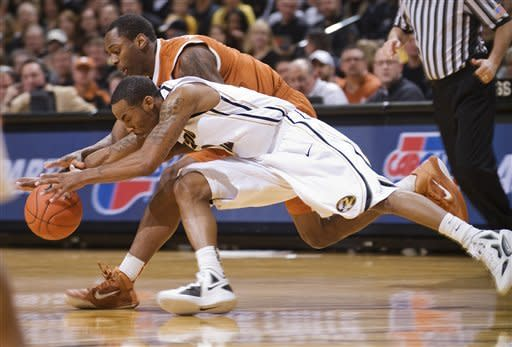 Missouri's Marcus Denmon, bottom, battles Texas' Sheldon McClellan, top, for a loose ball during the first half of an NCAA college basketball game Saturday, Jan. 14, 2012, in Columbia, Mo. (AP Photo/L.G. Patterson)