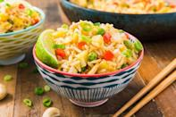 """<p>To give this rice more an island vibe, we fried the rice and veggies in coconut oil. If you don't have any on hand, use a vegetable oil instead. This stuff is seriously delicious. </p><p>Get the <a href=""""https://www.delish.com/uk/cooking/recipes/a30774801/easy-pineapple-fried-rice-recipe/"""" rel=""""nofollow noopener"""" target=""""_blank"""" data-ylk=""""slk:Pineapple Fried Rice"""" class=""""link rapid-noclick-resp"""">Pineapple Fried Rice</a> recipe.</p>"""