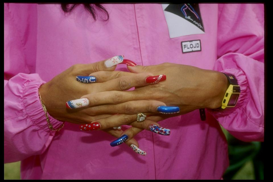 Florence Griffith-Joyner shows her nails during the 1991 Sports Festival.