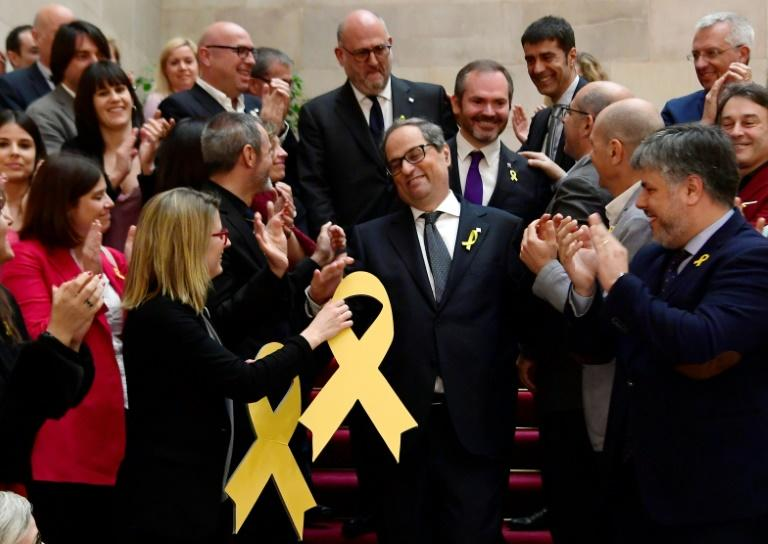 Catalan regional president Quim Torra and yellow ribbons