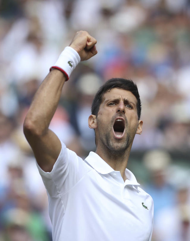 Serbia's Novak Djokovic celebrates winning a point against Spain's Roberto Bautista Agut in a Men's singles semifinal match on day eleven of the Wimbledon Tennis Championships in London, Friday, July 12, 2019. (Carl Recine/Pool Photo via AP)