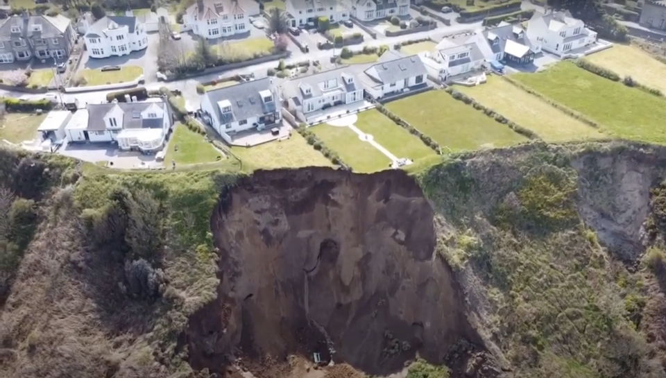 <p>Parts of peoples' gardens also tumbled onto the beach</p> (YouTube)