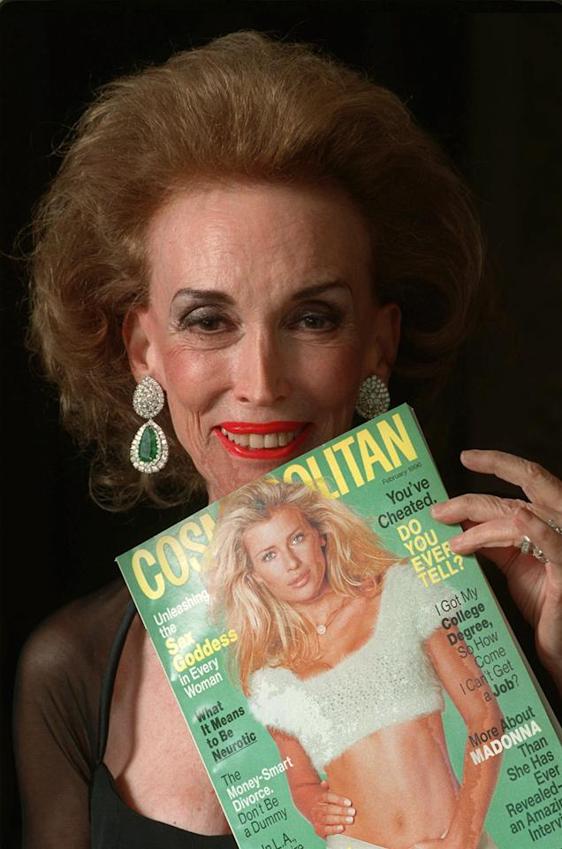 FILE - This Jan. 24, 1996 file photo shows Cosmopolitan Editor-in-Chief Helen Gurley Brown holding an issue of the magazine before a Waldorf-Astoria ceremony where she was honored with a Henry Johnson Fisher Award for lifetime achievement in the magazine industry in New York. Brown, longtime editor of Cosmopolitan magazine, died Monday, Aug. 13, 2012 at a hospital in New York after a brief hospitalization. She was 90. (AP Photo/Mark Lennihan, file)