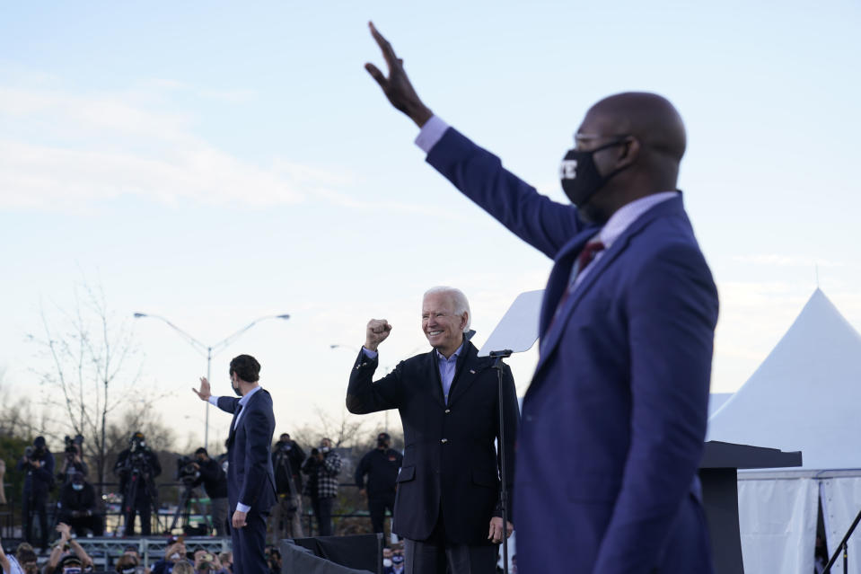 President-elect Joe Biden campaigns in Atlanta, Monday, Jan. 4, 2021, for Senate candidates Raphael Warnock, right, and Jon Ossoff, left. (AP Photo/Carolyn Kaster)
