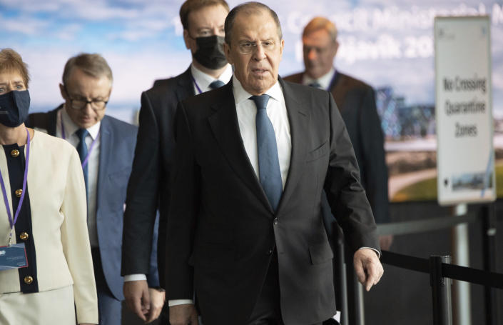 Russian Foreign Minister Sergey Lavrov centre, arrives for the Arctic Council Ministerial Meeting in Reykjavik, Iceland, Thursday, May 20, 2021. Top diplomats from the United States and Russia sparred politely in Iceland during their first face-to-face encounter, which came as ties between the nations have deteriorated sharply in recent months. (Saul Loeb/Pool Photo via AP)