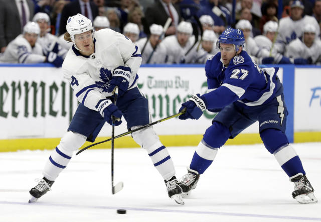 Toronto Maple Leafs right wing Kasperi Kapanen (24) passes off in front of Tampa Bay Lightning defenseman Ryan McDonagh (27) during the first period of an NHL hockey game, Thursday, Jan. 17, 2019, in Tampa, Fla. (AP Photo/Chris O'Meara)