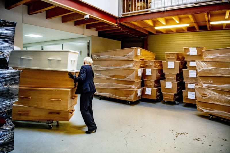 AMSTERDAM, NETHERLANDS - 2020/03/27: An employee of a funeral company arranges coffins in a storage area. Funeral services providers are increasing the production of coffins as they are anticipating a large number of funerals going to take place in the coming weeks as the number of people infected with the COVID-19 Coronavirus increases and the death rate climbs. (Photo by Robin Utrecht/SOPA Images/LightRocket via Getty Images)