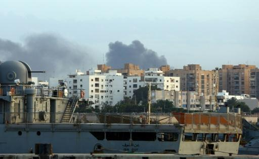 At least 28 dead as militias clash in Libya capital