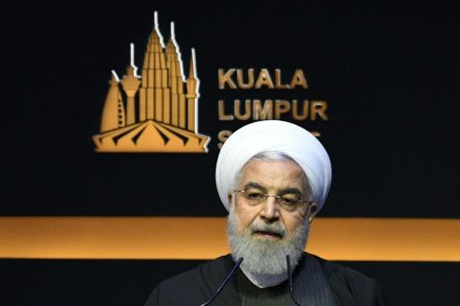 Iran's President Hassan Rouhani speaking during the opening ceremony of the Kuala Lumpur Summit of Muslim leaders