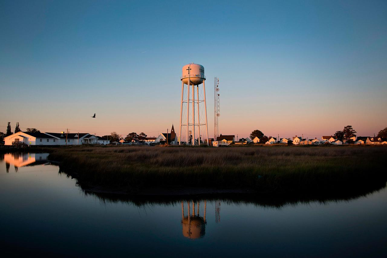 <p>The sun sets in Tangier, Virginia, May 15, 2017, where climate change and rising sea levels threaten the inhabitants of the slowly sinking island.<br /> (Jim Watson/AFP/Getty Images) </p>