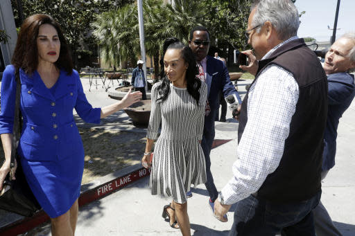 Elissa Ennis, former girlfriend of San Francisco 49ers linebacker Reuben Foster, center, walks out of Santa Clara County Superior Court with her attorney Stephanie Rickard, left, after testifying in Foster's preliminary hearing, Thursday, May 17, 2018, in San Jose, Calif. Foster pleaded not guilty Tuesday, May 8, 2018, to charges stemming from allegations that he attacked Ennis in their home in February. (AP Photo/Marcio Jose Sanchez)