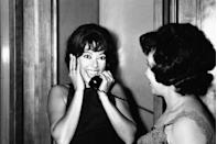 "<p>Rita Moreno couldn't contain her excitement while making a phone call after winning Best Supporting Actress for <em><a href=""https://www.goodhousekeeping.com/life/g4938/best-musical-movies/"" rel=""nofollow noopener"" target=""_blank"" data-ylk=""slk:West Side Story"" class=""link rapid-noclick-resp"">West Side Story</a></em>. One of the evening's stranger moments involved a New York City cab driver taking the stage to give host Bob Hope a homemade Oscar statue. </p>"