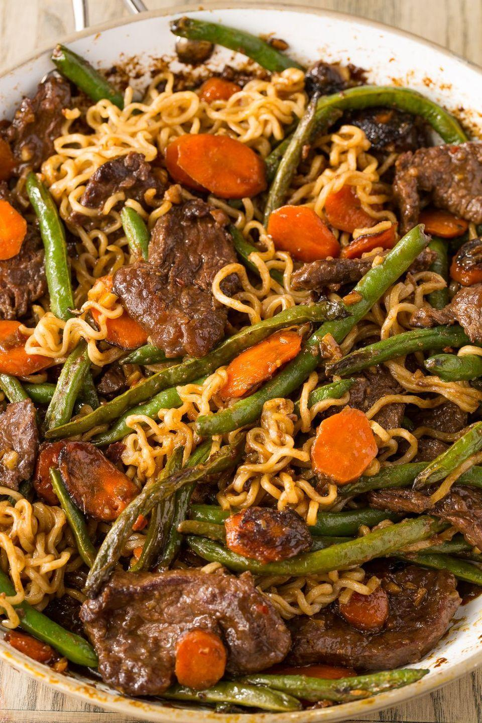 """<p>This stir-fry has a ginger-garlic kick that you won't be able to resist.</p><p>Get the <a href=""""http://www.delish.com/uk/cooking/recipes/a28756691/ginger-beef-stir-fry-with-ramen-recipe/"""" rel=""""nofollow noopener"""" target=""""_blank"""" data-ylk=""""slk:Ginger Beef Stir Fry with Ramen"""" class=""""link rapid-noclick-resp"""">Ginger Beef Stir Fry with Ramen</a> recipe.</p>"""