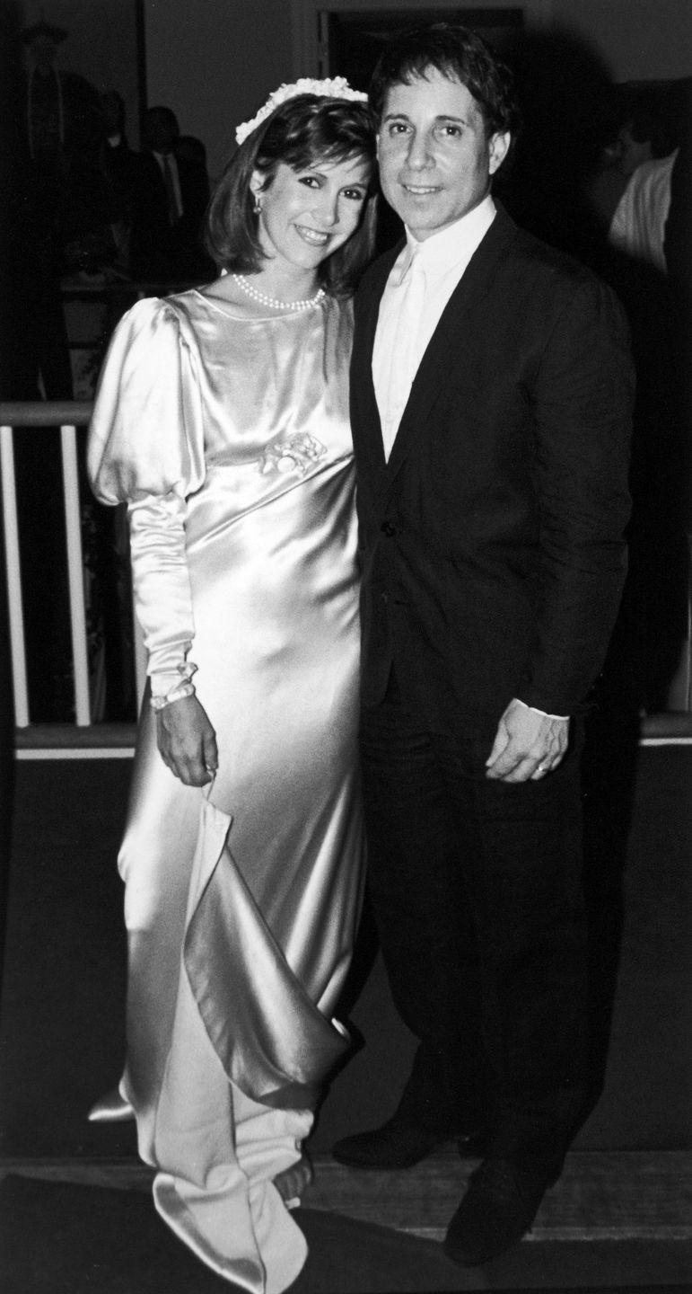 "<p>The <em>Star Wars </em>star and Paul Simon got married on August 16, 1983 in New York City. The couple were married for a little over a year before divorcing. Although they reunited after the divorce, it wasn't long-lived. Simon's song ""Hearts and Bones"" is famously about their long romance. </p>"