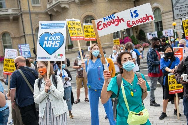 NHS staff and supporters take part in a protest march in central London