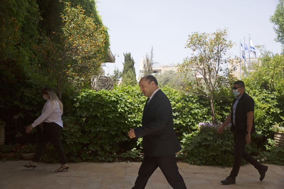 Naftali Bennett, head of the Yamina Party, arrives to meet with Israeli President Reuvin Rivlin in Jerusalem, Wednesday, May 5, 2021. Israel's president on Wednesday signaled he would move quickly to task a new candidate with forming a government after Prime Minister Benjamin Netanyahu failed to do so ahead of a midnight deadline. (AP Photo/Maya Alleruzzo)