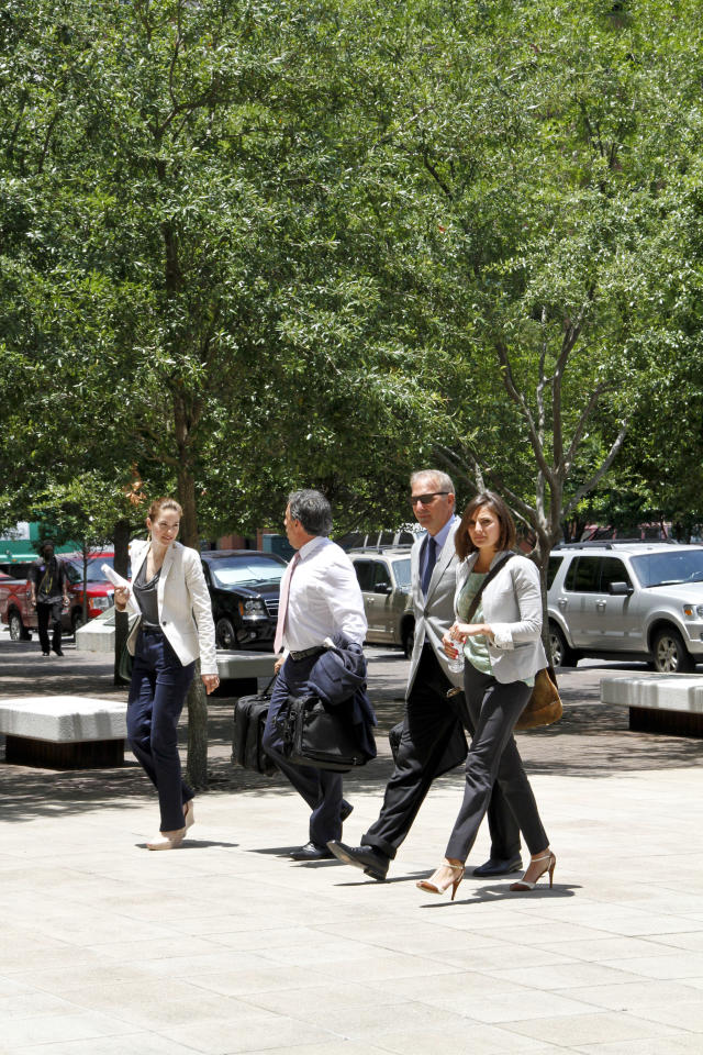 NEW ORLEANS, LA - JUNE 05: Actor Kevin Costner (2ndR) arrives with members of his legal team at the U.S. District Court Eastern District Of Louisiana on June 5, 2012 in New Orleans, Louisiana.  Stephen Baldwin & Spyridon Contogouis are suing Kevin Costner, Patrick Smith, WestPac Resources, LLC & Rabobank, N.A. for misrepresentation in connection with the sale of stock in a company that made oil spill cleanup machines prior to BP placing a $52 million order for the technology. (Photo by Monica McKlinski/Getty Images)