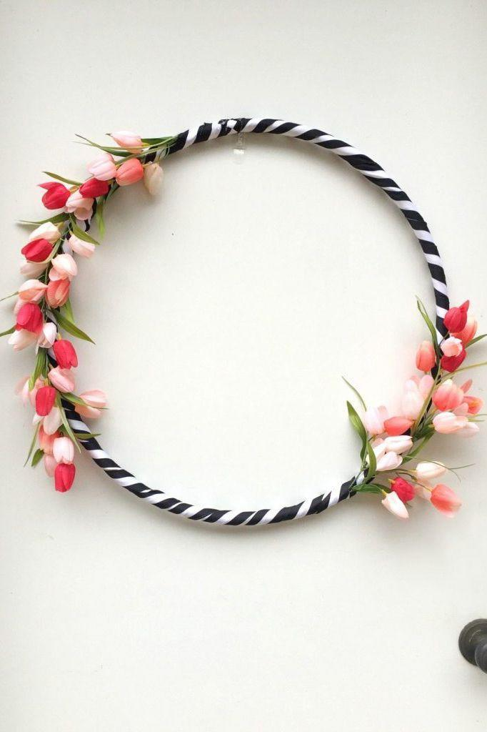"""<p>Who knew a <a href=""""https://www.countryliving.com/diy-crafts/a41853/hula-hoop-wreaths/"""" rel=""""nofollow noopener"""" target=""""_blank"""" data-ylk=""""slk:hula hoop from the dollar store"""" class=""""link rapid-noclick-resp"""">hula hoop from the dollar store</a> could become such a bold, beautiful Easter wreath?</p><p><strong>Get the tutorial at <a href=""""https://refreshrestyle.com/hula-hoop-spring-wreath/"""" rel=""""nofollow noopener"""" target=""""_blank"""" data-ylk=""""slk:Refresh Restyle"""" class=""""link rapid-noclick-resp"""">Refresh Restyle</a>.</strong></p><p><strong><a class=""""link rapid-noclick-resp"""" href=""""https://www.amazon.com/Sntieecr-Macrame-Wedding-Catcher-Hanging/dp/B07Z4X8R91?tag=syn-yahoo-20&ascsubtag=%5Bartid%7C10050.g.4088%5Bsrc%7Cyahoo-us"""" rel=""""nofollow noopener"""" target=""""_blank"""" data-ylk=""""slk:SHOP METAL HOOP WREATH FORMS"""">SHOP METAL HOOP WREATH FORMS</a><br></strong></p>"""