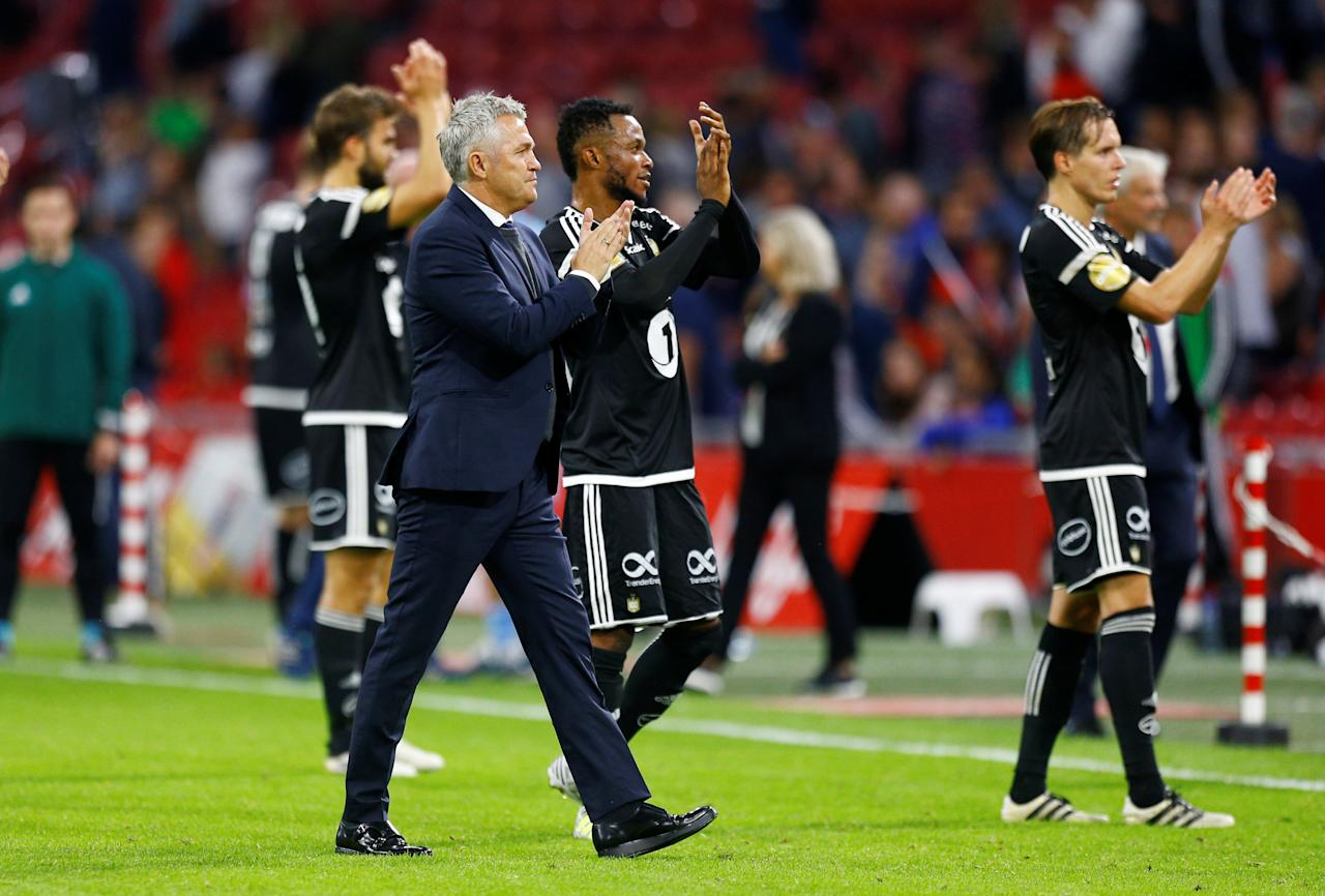 Soccer Football - Europa League - Playoffs – Ajax Amsterdam v Rosenborg BK - Amsterdam, Netherlands - August 17, 2017   Rosenborg coach Kare Ingebrigtsen applauds the fans at the end of the match    REUTERS/Michael Kooren