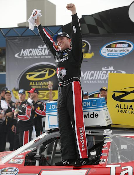 Driver Regan Smith celebrates in Victory Lane after winning the NASCAR Nationwide series Alliance Truck Parts 250 auto race at Michigan International Speedway, Saturday, June 15, 2013 in Brooklyn, Mich. (AP Photo/Carlos Osorio)