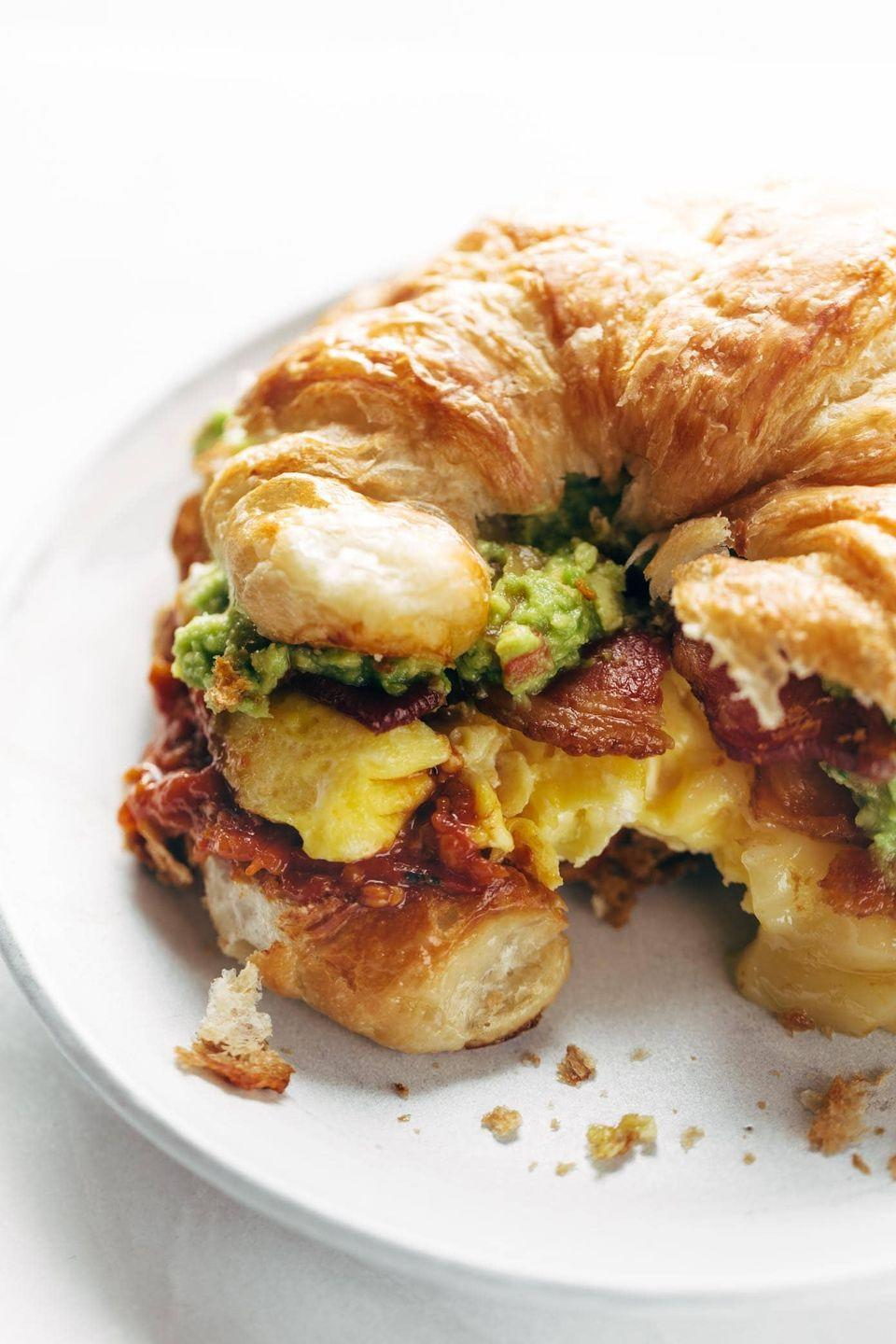 """<p>The garlic butter tomato sauce makes a typical sandwich unforgettably delicious.</p><p><strong>Get the recipe at <a href=""""https://pinchofyum.com/breakfast-sandwich"""" rel=""""nofollow noopener"""" target=""""_blank"""" data-ylk=""""slk:Pinch of Yum"""" class=""""link rapid-noclick-resp"""">Pinch of Yum</a>.</strong></p>"""