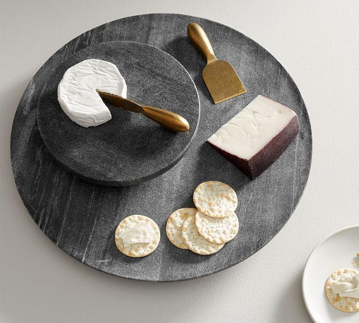 """<p><strong>Black Marble Lazy Susan</strong></p><p>potterybarn.com</p><p><strong>$69.50</strong></p><p><a href=""""https://go.redirectingat.com?id=74968X1596630&url=https%3A%2F%2Fwww.potterybarn.com%2Fproducts%2Fblack-marble-lazy-susan&sref=https%3A%2F%2Fwww.redbookmag.com%2Fhome%2Fg35380342%2Fhow-to-organize-a-fridge%2F"""" rel=""""nofollow noopener"""" target=""""_blank"""" data-ylk=""""slk:BUY NOW"""" class=""""link rapid-noclick-resp"""">BUY NOW</a></p><p>Meats should be stored on the lowest shelf to prevent any drippings from reaching other foods. And if you're worried about drippings or you want to minimize fridge clean up, put a tray under them. Even better? A lazy Susan so you can grab and go more quickly. </p>"""