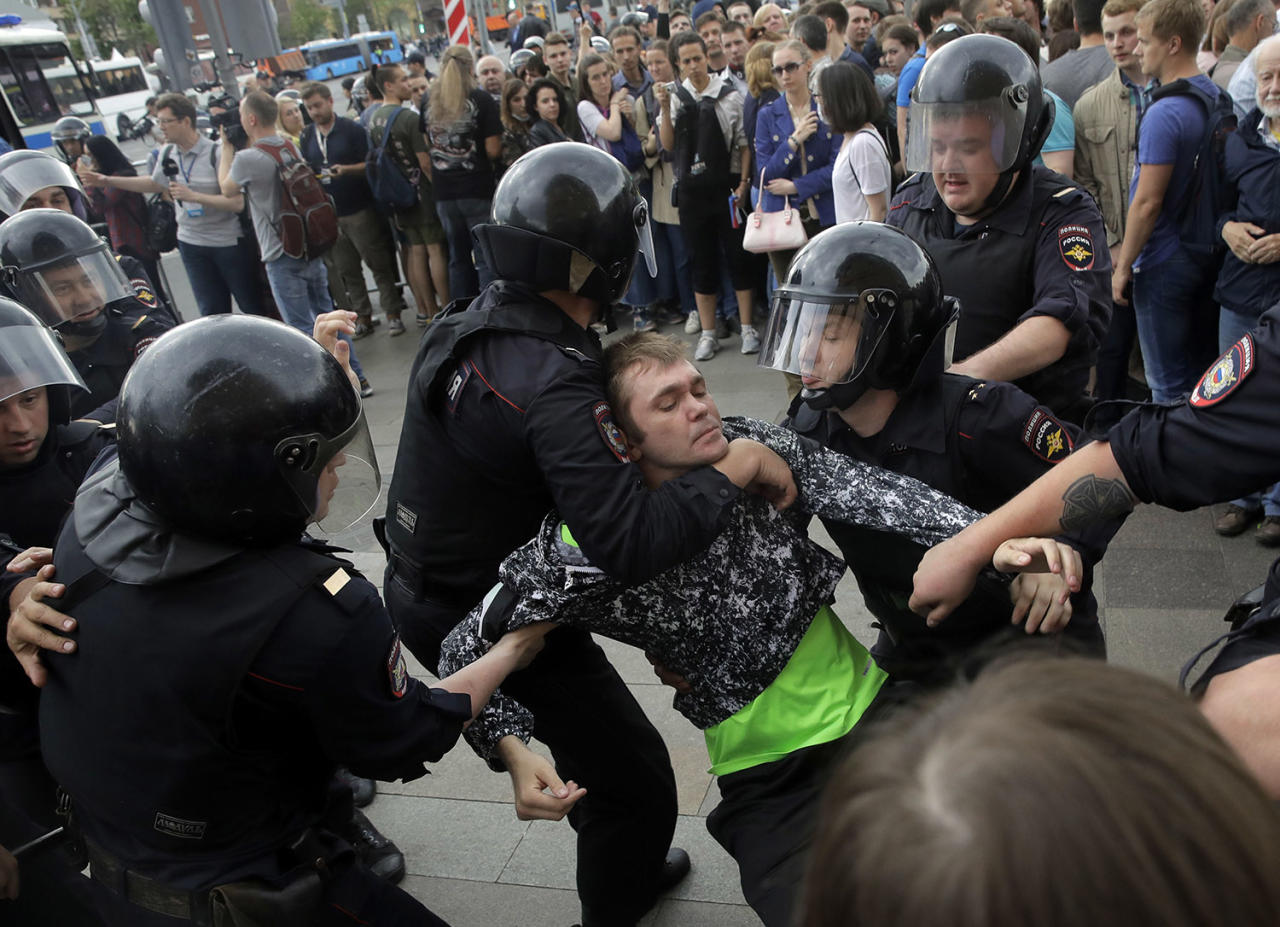 <p>Police detain a protester during a demonstration in downtown Moscow, Russia, Monday, June 12, 2017. (Pavel Golovkin/AP) </p>