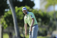 Webb Simpson reacts after missing a putt on the 12th green during the first round of the Sony Open golf tournament Thursday, Jan. 14, 2021, at Waialae Country Club in Honolulu. (AP Photo/Jamm Aquino)