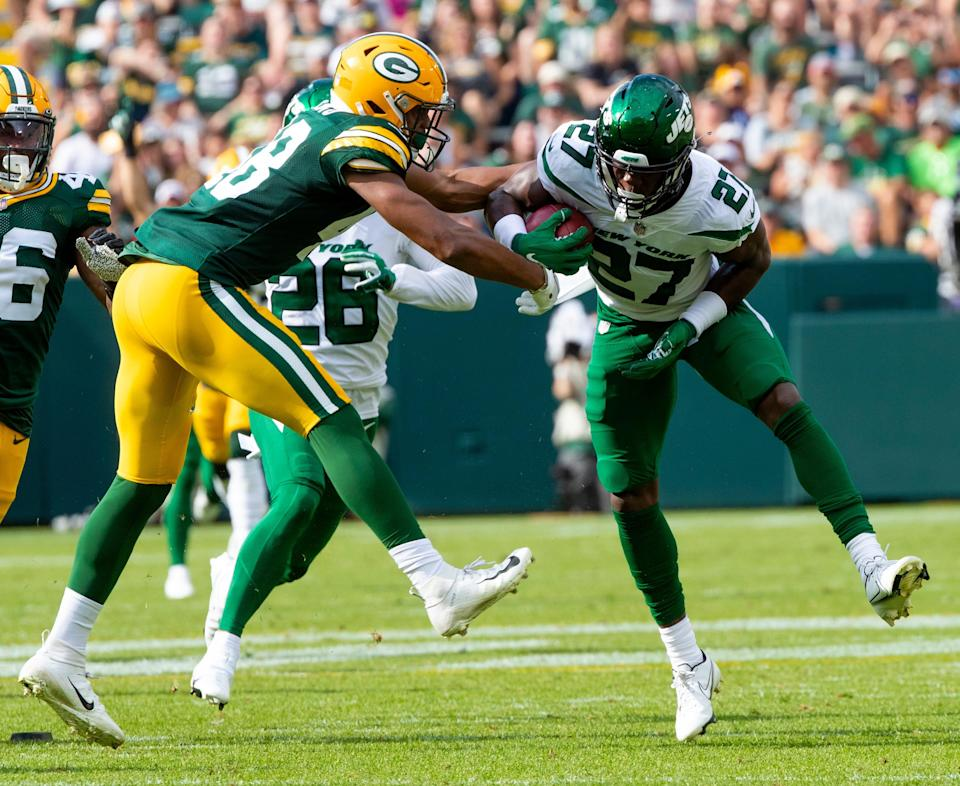 Green Bay Packers cornerback Kabion Ento (48) tackles New York Jets cornerback Corey Ballentine (27) in the first half during their preseason football game on Saturday, August 21, 2021, at Lambeau Field in Green Bay, Wis. Samantha Madar/USA TODAY NETWORK-Wisconsin