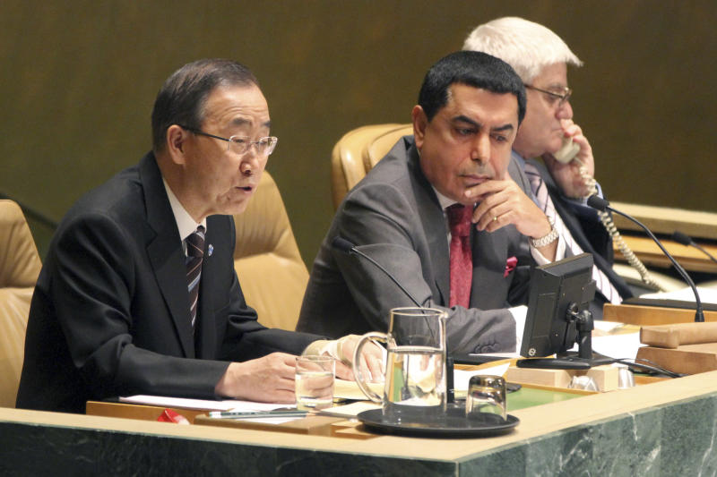 United Nations Secretary-General Ban Ki-moon, left, addresses the United Nations General Assembly on the situation in the Syrian Arab Republic as Nassir Abdulaziz Al -Nasser President of the 66th Session of the General Assembly listens, Thursday, June 7, 2012 at United Nations headquarters.  (AP Photo/Mary Altaffer)
