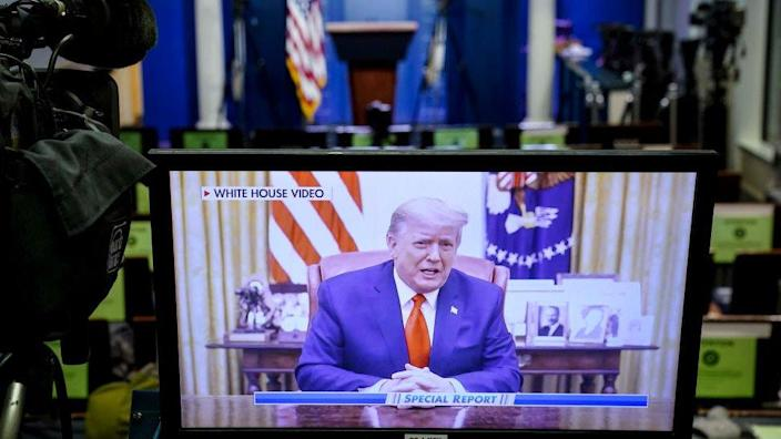 A television monitor in the White House Press Briefing Room displays a recorded address by former President Donald Trump