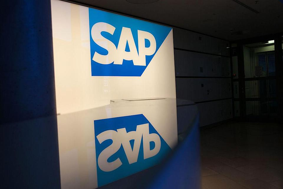 An illuminated SAP AG logo sits on display inside the business-software maker's headquarters in Walldorf, Germany, on Monday, Feb. 24, 2014. SAP AG co-Chief Executive Officer Bill McDermott, targeting the growing online software market, said he plans to tap a greater portion of customers' spending. Photographer: Krisztian Bocsi/Bloomberg via Getty Images