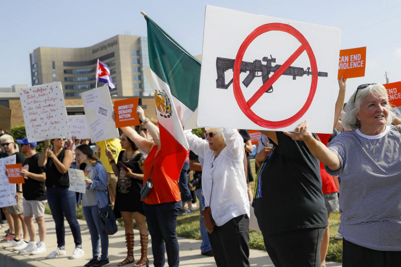 FILE - In this Aug. 7, 2019, file photo, demonstrators gather to protest after a mass shooting that occurred in Dayton, Ohio. The latest mass shootings in the United States have triggered multiple countries to warn their citizens to be wary of travel conditions there. (AP Photo/John Minchillo, File)