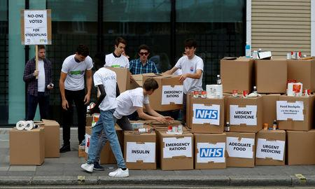 FILE PHOTO: Protesters demonstrate against the possible stockpiling of medecines and food in the event of a no-deal Brexit in London, Britain. Aug 22, 2018. REUTERS/Peter Nicholls/File Photo