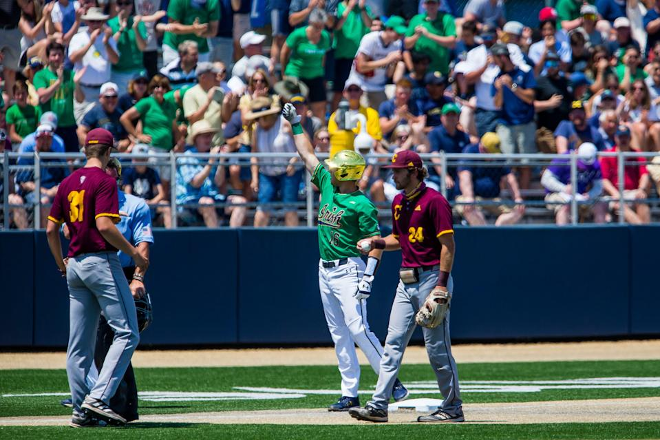 Notre Dame's Jared Miller (16) celebrates a triple as Central Michigan's Aidan Shepardson (24) holds the ball during the Notre Dame vs. Central Michigan NCAA tournament baseball game Friday, June 4, 2021 at Frank Eck Stadium in South Bend.