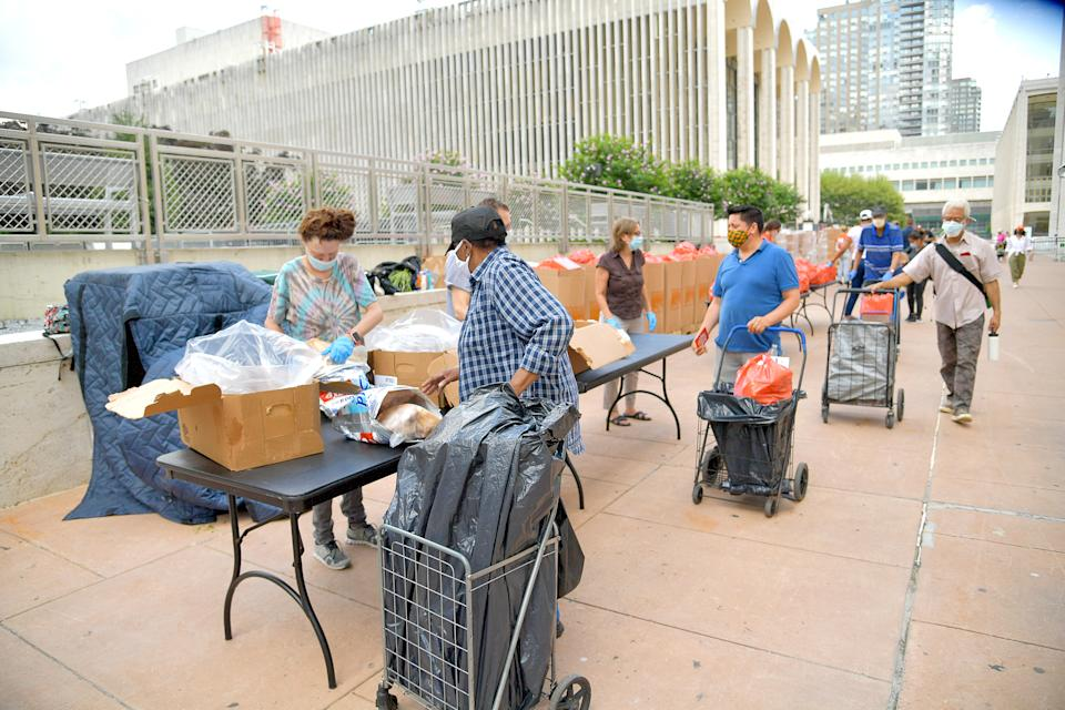 New Yorkers in need receive free produce, dry goods, and meat at a Food Bank For New York City distribution event at Lincoln Center on July 29, 2020, in New York City. (Photo by Michael Loccisano/Getty Images for Food Bank For New York City)