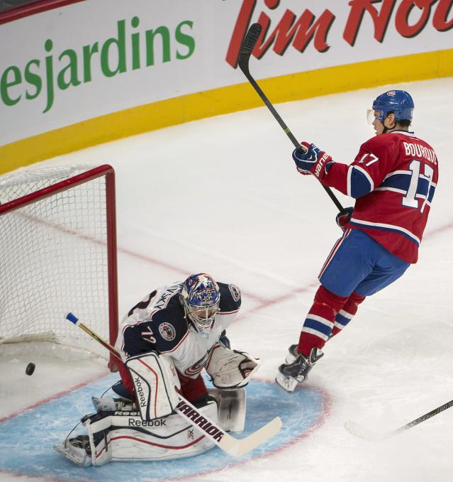 Montreal Canadiens' Rene Bourque, (17), scores during the first period of an NHL hockey game, Thursday, Oct. 17, 2013 in Montreal. (AP Photo/The Canadian Press, Peter McCabe)